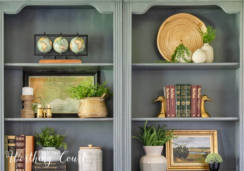 closeup of accessories on a pair of gray bookcases