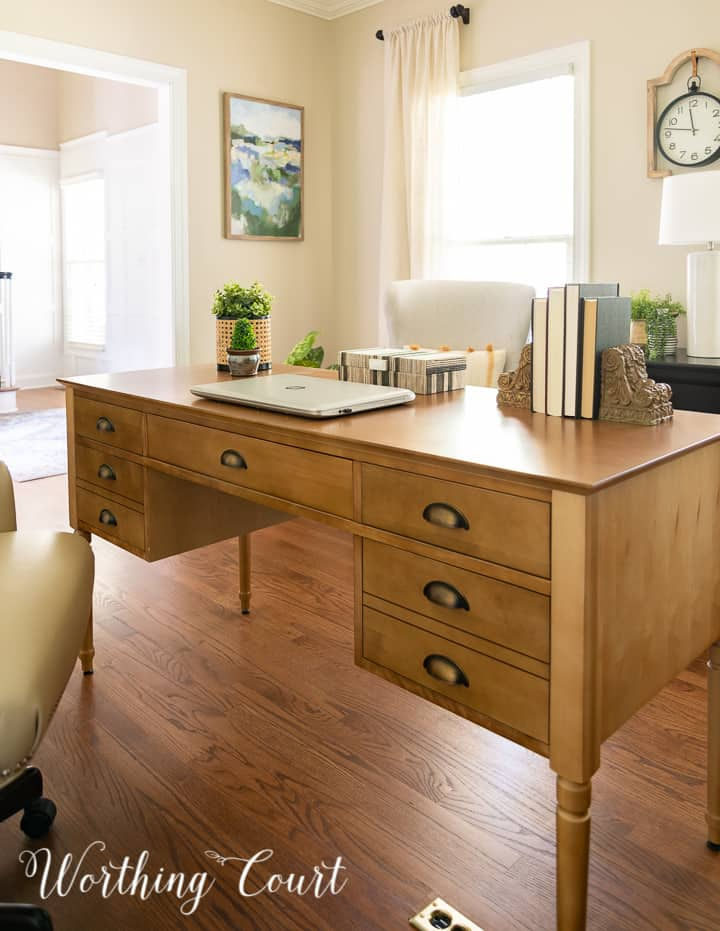 front of a natural wood toned desk