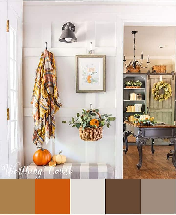 white wall with fall decorations hanging from hooks