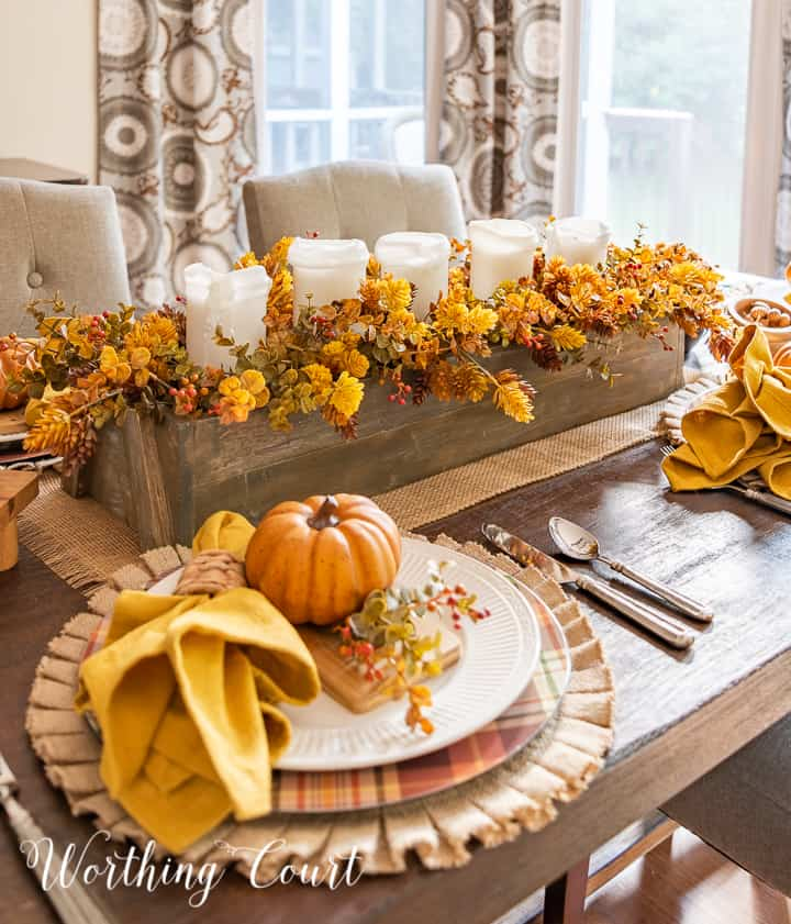 fall tablescape and centerpiece with tones of gold and rustic orange