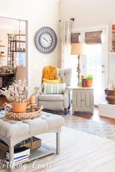 family room in neutral colors with fall decor