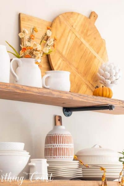 open wood shelves with white and wood fall decor