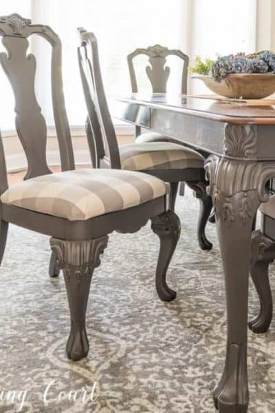 gray dining room chair with gray and white buffalo check fabric seat